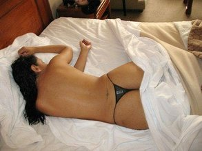 Latina wife showing off her body in see-through panties and spreading her legs