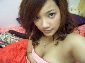 Asian brunette girlfriend showing her best selfies: major cleavage alert