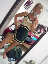 Trashy-looking blonde cheerleader GF showing off her pussy and ass