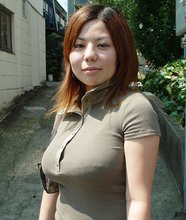 Perky and thick Asian wife showing off her impressive knockers at night