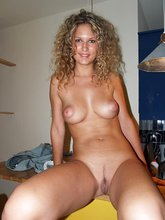 Curly-haired wife in white lingerie seducing with her tanned and toned body