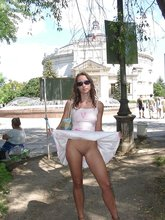 Skirt-wearing brown-haired GF posing in public and walking around totally nude