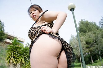 Exotic Latina girlfriend slowly taking off her tight leopard print dress