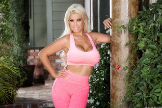 Tight pink yoga pants blonde bombshell posing without her girlfriends