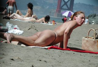 Voyeur-style picture collection featuring someone's SO sunbathing topless