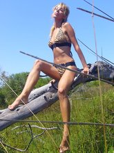 Leggy and mature blonde wife showing her incredible tits outdoors