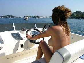 Big ass and tits brunette wife sunbathing completely naked on a boat
