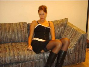 Long-legged and stockings-wearing amateur hottie spreading her legs on a couch