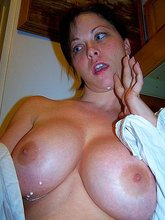 Massive tits amateur MILF showing off her massive tits in a white wet t-shirt