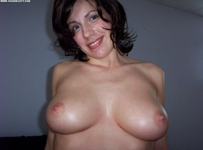 Short-haired MILF shows that ass and those natural tits to her hung partner