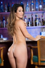 Leggy Latina girlfriend showing off her naked body next to a bar counter