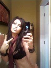 Trashy-looking brunette slut seducing her boyfriend with sexy selfies