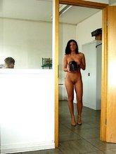 Short-haired brunette bombshell walking around town completely naked
