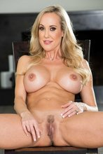 Busty blonde MILF with a six pack showing off her hairy pussy on camera