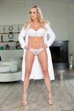 Luxurious blonde MILF takes off her white bathrobe to show off that body