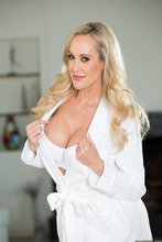 Seductive fair-haired cougar opens up her white bathrobe to seduce