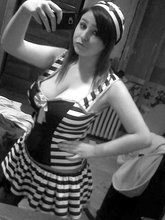 Dark-haired and pudgy emo girl posing half-naked and totally naked