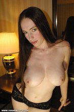 Busty and barely legal brunette squeezing her tasty-looking tits on cam