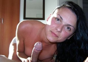 Dark-haired hottie sucking cock along with some other cocksuckers
