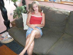 Denim skirt wearing blonde flashing her red panties before posing naked