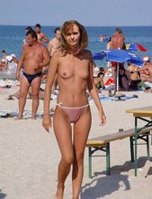 Bikini-clad babes showing their perfect tits and naked bodies on a beach