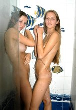 Blond-haired beauties gleefully making out in the shower