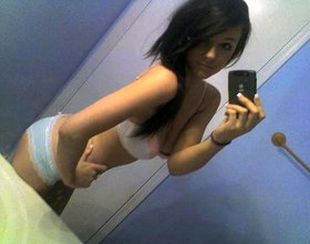 Dark-haired beauty with amazing tits teasing with her sexy body