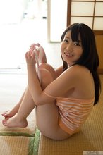 Playful and busty Japanese teen takes off her panties to tease that slit