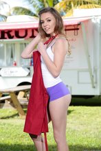 Teen takes off red apron to pose half-naked next to her food truck