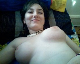 Edgy-looking brunette posing with her immaculate natural tits out