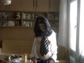 Dark-haired bombshell flashing her big teen tits in a schoolgirl-y get-up