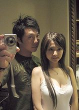 Dark-haired Asian beauty poses with her boyfriend and flashes her tits