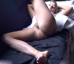 Tramp stamp blonde shows her luxurious young body and teases her pussy