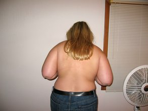 Fat blonde takes off her top along with her XXXL jeans and sexy panties