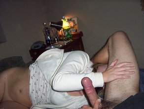 Short-haired blonde devouring this dude's cock, licking his hairy balls