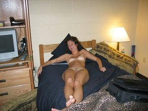 Skinny brunette with tan lines and hairy pussy gets to ride his big dick