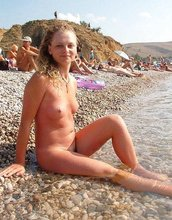 Collection of high-quality pictures featuring naked babes on a beach