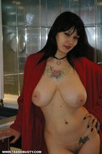 Red get-up pale-looking brunette in boots shows her big breasts for you