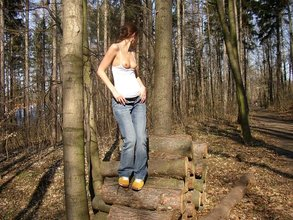 Short-haired teen decides to undress in public, pose naked in the woods