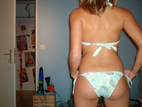Blond-haired teen takes off her sexy lingerie to pose topless