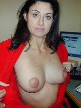 Red get-up brunette showing off her massive tits and nude body in private