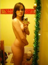 Dark-haired teen posing topless in her black panties, posing totally nude too