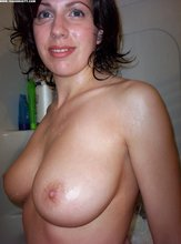 Busty brunette showering and showing off her amazing wet body in HQ