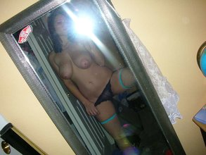 Tiny panties teen showing off her natural tits in the mirror