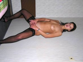 Black stockings wavy-haired brunette teasing her pussy with a big toy