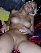 Short-haired blonde with perfect breasts posing half-naked and totally naked