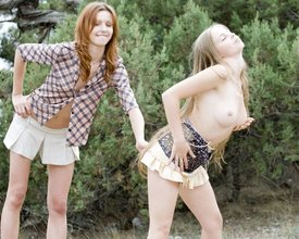 Long-legged blonde in sexy black panties gets seduced by her redheaded GF
