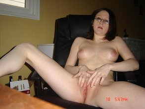 Stockings-clad nerdy brunette shows her hairy pussy and masturbates
