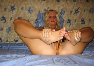 Stockings-clad blonde showing off her sexy feet and getting fucked