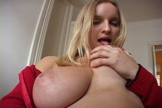 Busty blonde in a red hoodie decides to pull down her jeans to masturbate